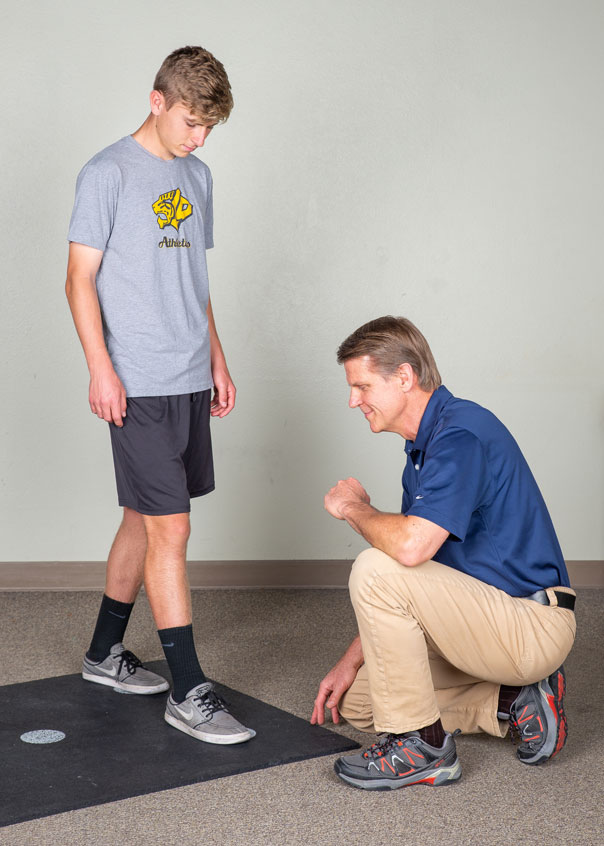 Doctor looking at athlete's feet
